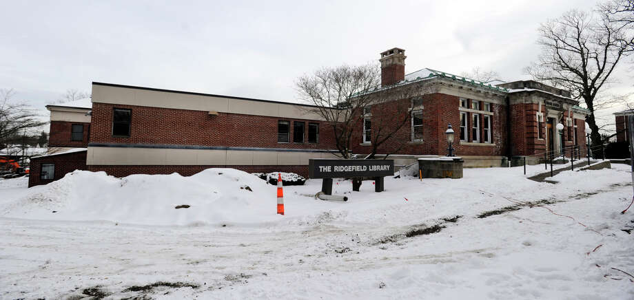 The Ridgefield Library is scheduled to be demolished, making way for a new 20 million dollar replacement. The 1903 Morris building that faces Main Street will be kept. Photo: Carol Kaliff / The News-Times