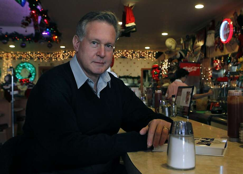 Dr. Robert Lustig at Manor Coffee Shop in West Portal puts a shaker of sugar, which he calls the culprit behind obesity, in front of him. Photo: Paul Chinn, The Chronicle