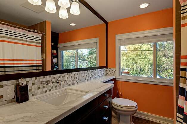 Bathroom of 12514 25th Ave. N.E. The 1,830-square-foot house, built in 1924, has three bedrooms, 1.75 bathrooms, an updated kitchen, a backyard deck and patio, and a shed on an 8,438-square-foot lot. It's listed for $439,950. Photo: Courtesy April Rauch And Mark Emily/Windermere Real Estate