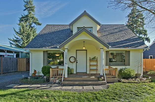 Moving up to $439,950, here's 12514 25th Ave. N.E. The 1,830-square-foot house, built in 1924, has three bedrooms, 1.75 bathrooms, an updated kitchen, a backyard deck and patio, and a shed on an 8,438-square-foot lot. Photo: Courtesy April Rauch And Mark Emily/Windermere Real Estate