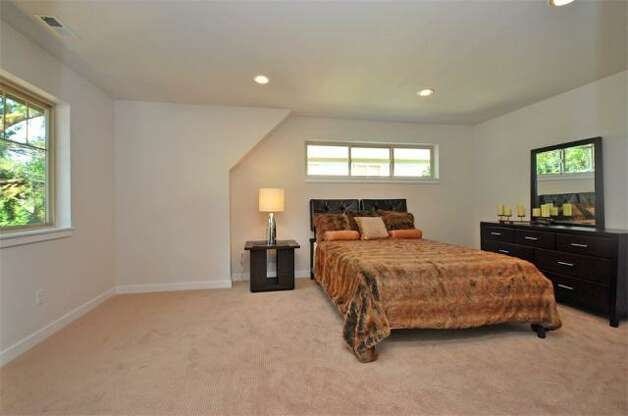 Master bedroom of 12036 25th Ave. N.E. The 2,100-square-foot house, built in 2012, has four bedrooms, three bathrooms, a floating staircase, a deck and a two-car garage on a 7,274-square-foot lot. It's listed for $499,000. Photo: Deborah Arends/RE/MAX Northwest Realtors