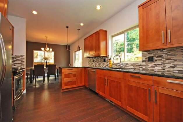Kitchen of 12036 25th Ave. N.E. The 2,100-square-foot house, built in 2012, has four bedrooms and three bathrooms -- including a master suite with a five-piece bathroom -- a floating staircase, a deck and a two-car garage on a 7,274-square-foot lot. It's listed for $499,000. Photo: Deborah Arends/RE/MAX Northwest Realtors