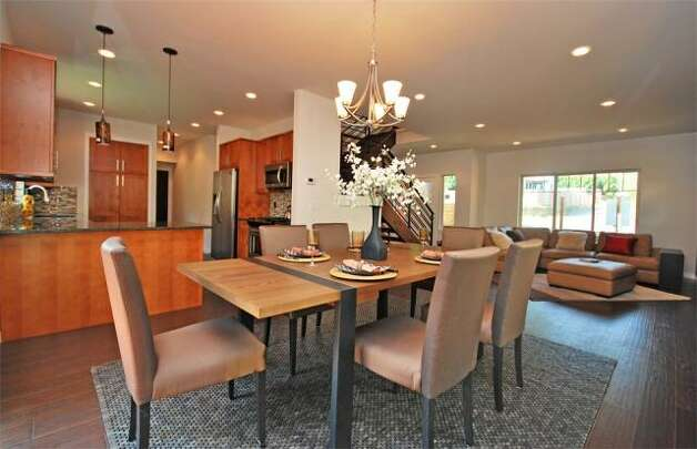 Dining room of 12036 25th Ave. N.E. The 2,100-square-foot house, built in 2012, has four bedrooms and three bathrooms -- including a master suite with a five-piece bathroom -- a floating staircase, a deck and a two-car garage on a 7,274-square-foot lot. It's listed for $499,000. Photo: Deborah Arends/RE/MAX Northwest Realtors