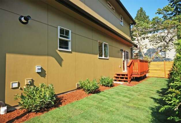 Yard of 12036 25th Ave. N.E. The 2,100-square-foot house, built in 2012, has four bedrooms and three bathrooms -- including a master suite with a five-piece bathroom -- a floating staircase, a deck and a two-car garage on a 7,274-square-foot lot. It's listed for $499,000. Photo: Deborah Arends/RE/MAX Northwest Realtors
