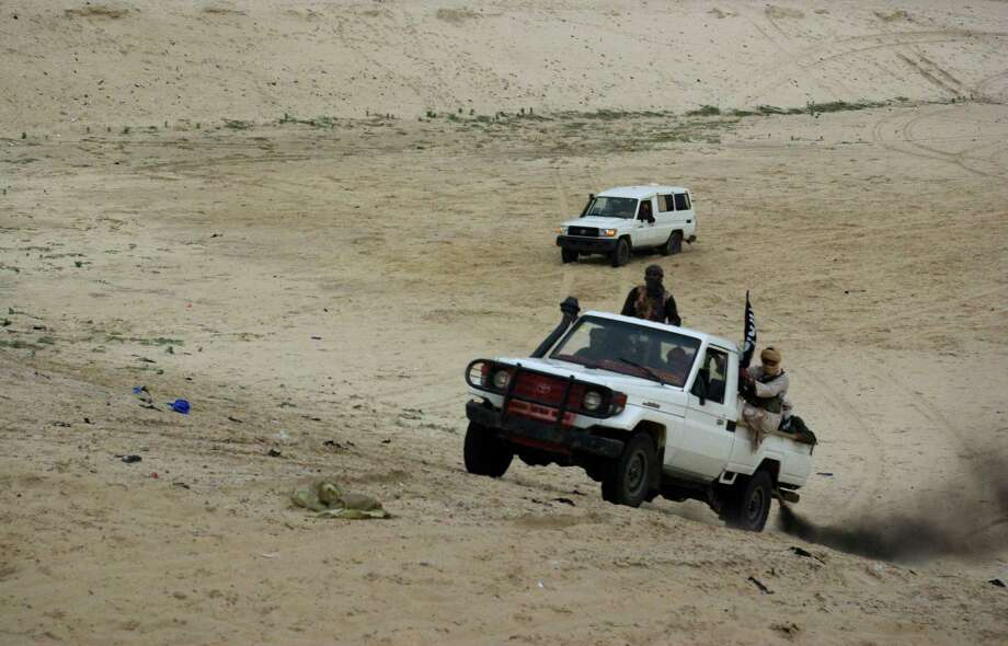 Radicals from the Islamist group Ansar Dine storm across the desert in September after performing a public amputation, severing the hand of a young man found guilty of stealing rice, in Timbuktu, Mali. Photo: STR / AP
