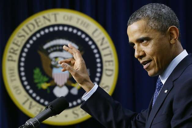 "President Barack Obama gestures as he speaks about the fiscal cliff, Monday, Dec. 31, 2012, in the South Court Auditorium at the White House in Washington. The president said it appears that an agreement to avoid the fiscal cliff is ""in sight,"" but says it's not yet complete and work continues.  (AP Photo/Charles Dharapak) Photo: Charles Dharapak, Associated Press"