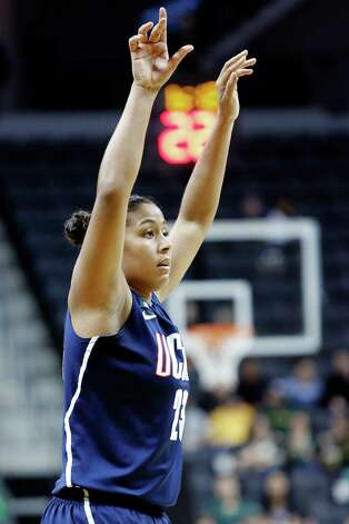 Connecticut forward Kaleena Mosqueda-Lewis watches her 3-pointer during the second half of an NCAA college basketball game against Oregon in Eugene, Ore., Monday, Dec. 31, 2012. Mosqueda-Lewis scored 19 points as Connecticut won 95-51. (AP Photo/Don Ryan) Photo: Don Ryan, Associated Press / AP