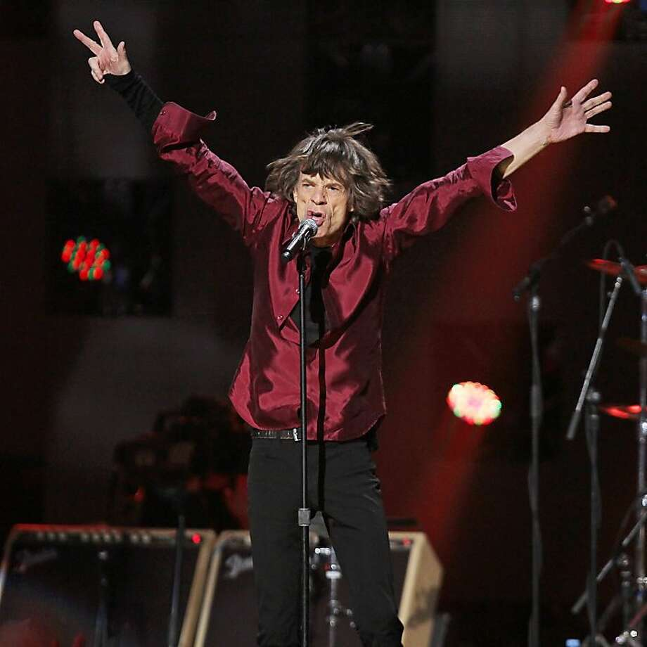 This image released by Starpix shows Mick Jagger of The Rolling Stones performing at the 12-12-12 The Concert for Sandy Relief at Madison Square Garden in New York on Wednesday, Dec. 12, 2012. Proceeds from the show will be distributed through the Robin Hood Foundation. (AP Photo/Starpix, Dave Allocca) Photo: Dave Allocca, Associated Press