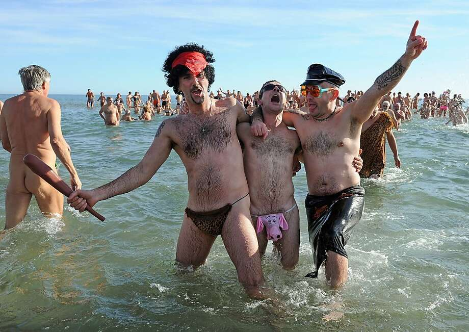 Revelers celebrate the New Year on a nude beach in Le Cap d'Agde, France, where Speedos are considered modest attire. Photo: Pascal Guyot, AFP/Getty Images