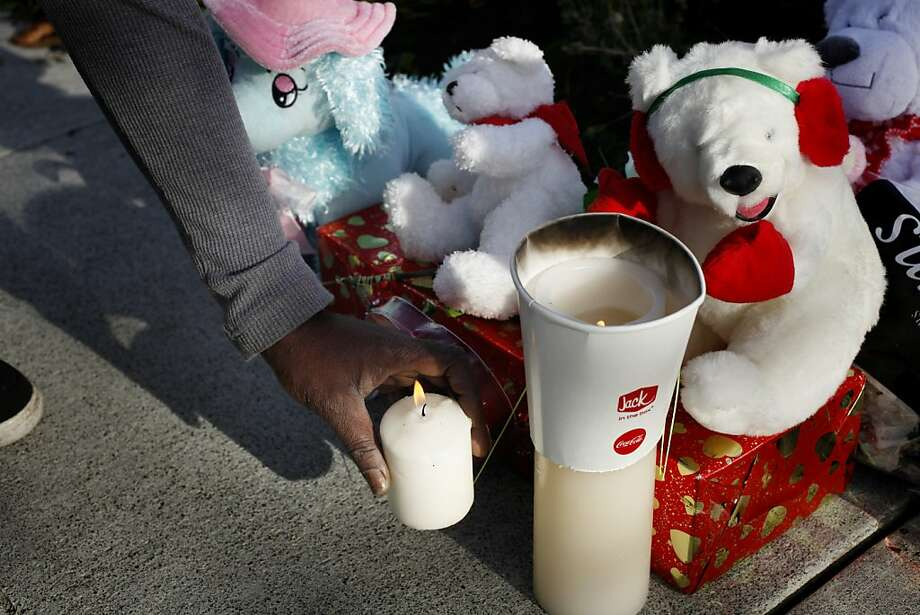Sharon Jackson lights a candle at the memorial. Photo: Lacy Atkins, The Chronicle