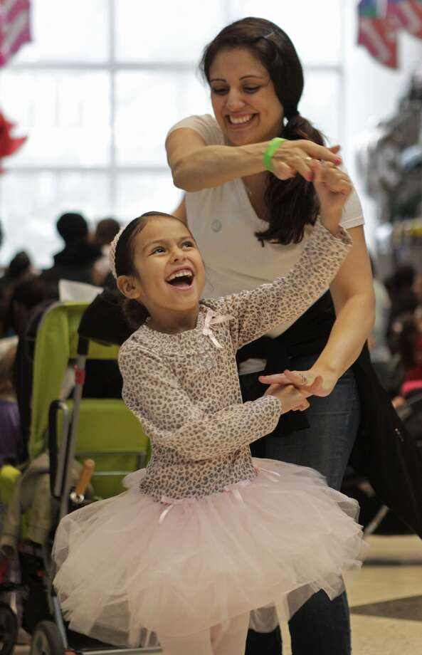 Dilynn Jimenez,  6,  and her  mother,  Ludivina Gutierrez,  of Humble, show off their dance moves at the museum.