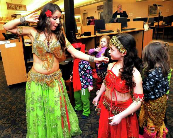 "Careesah instructs Jillian Ganim, 7, during ""Belly Dancing for Kids,"" a First Night performance at the Danbury Library Monday, Dec. 31, 2012. Photo: Michael Duffy"