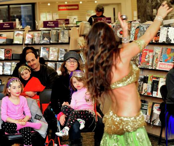 "Audience members watch Careesah perform during ""Belly Dancing for Kids,"" a First Night performance at the Danbury Library Monday, Dec. 31, 2012. Photo: Michael Duffy"