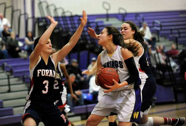 Foran High School's #3 Danielle Kemp, left, against Westhill High School # 11 Meg D'Alessandro at girls basketball tournament at Westhill at Stamford, Conn., Monday, December 31, 2012. Photo: Helen Neafsey / Greenwich Time