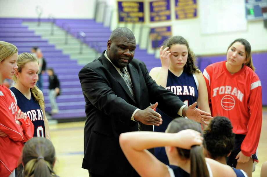 Foran High School girls basketball coach Scott Nails watches the team during Westhill against Foran High School tournament at Westhill in Stamford, Conn., Monday, December 31, 2012. Photo: Helen Neafsey / Greenwich Time