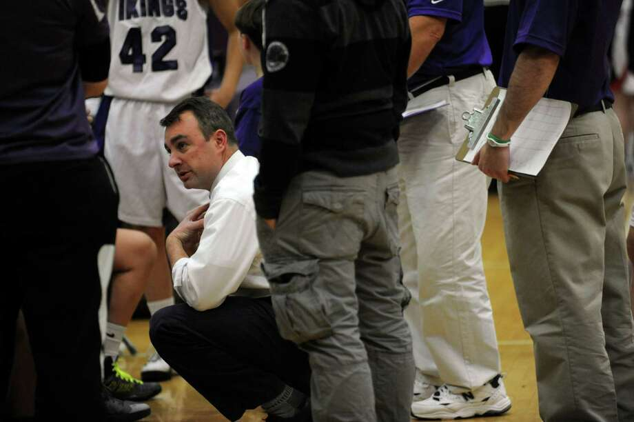 Westhill High School girls basketball coach Mike King watches the team during Westhill against Foran High School tournament at Westhill in Stamford, Conn., Monday, December 31, 2012. Photo: Helen Neafsey / Greenwich Time
