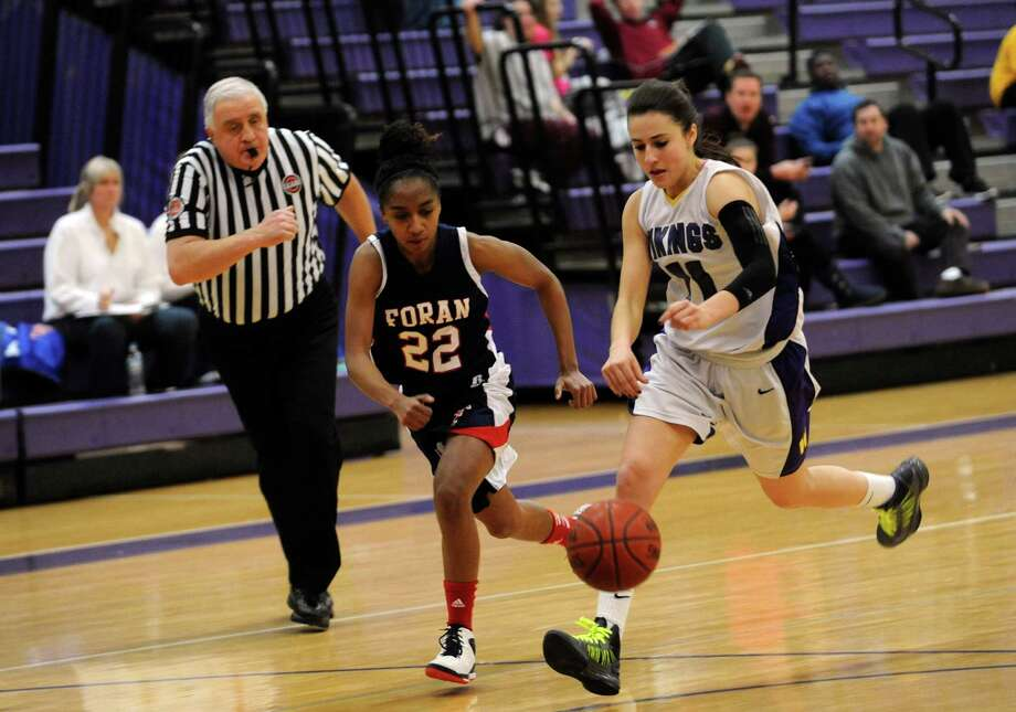 Foran High School's #22 Tengya McLaughlin against Westhill High School's #11 Meg D'Alessandro at girls basketball tournament at Westhill at Stamford, Conn., Monday, December 31, 2012. Photo: Helen Neafsey / Greenwich Time