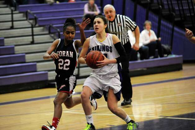 Foran High School's #22 Tengya McLaughin, left, against Westhill High School's #11 Meg D'Alessandro at girls basketball tournament at Westhill at Stamford, Conn., Monday, December 31, 2012. Photo: Helen Neafsey / Greenwich Time