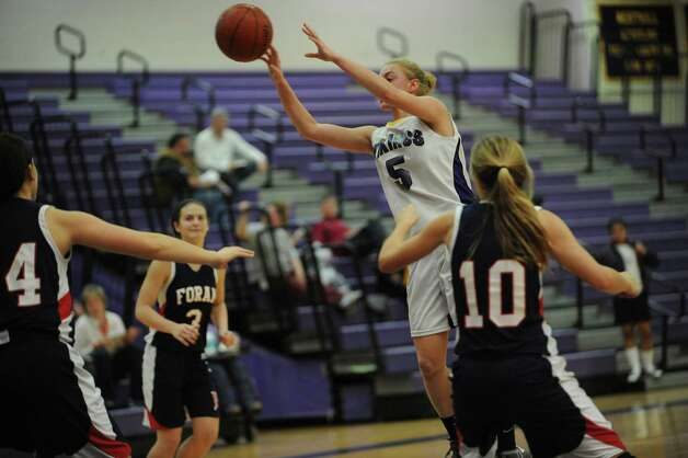 Westhill High School's #5 Steph Roones against Foran High School's #4 Alex Librandi, # 3 Erica Gambino and #10 Kelly Quinn at girls basketball tournament at Westhill at Stamford, Conn., Monday, December 31, 2012. Photo: Helen Neafsey / Greenwich Time