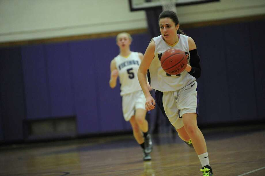 Westhill High School's #11 Meg D'Alessandro against Foran High School at girls basketball tournament at Westhill at Stamford, Conn., Monday, December 31, 2012. Photo: Helen Neafsey / Greenwich Time