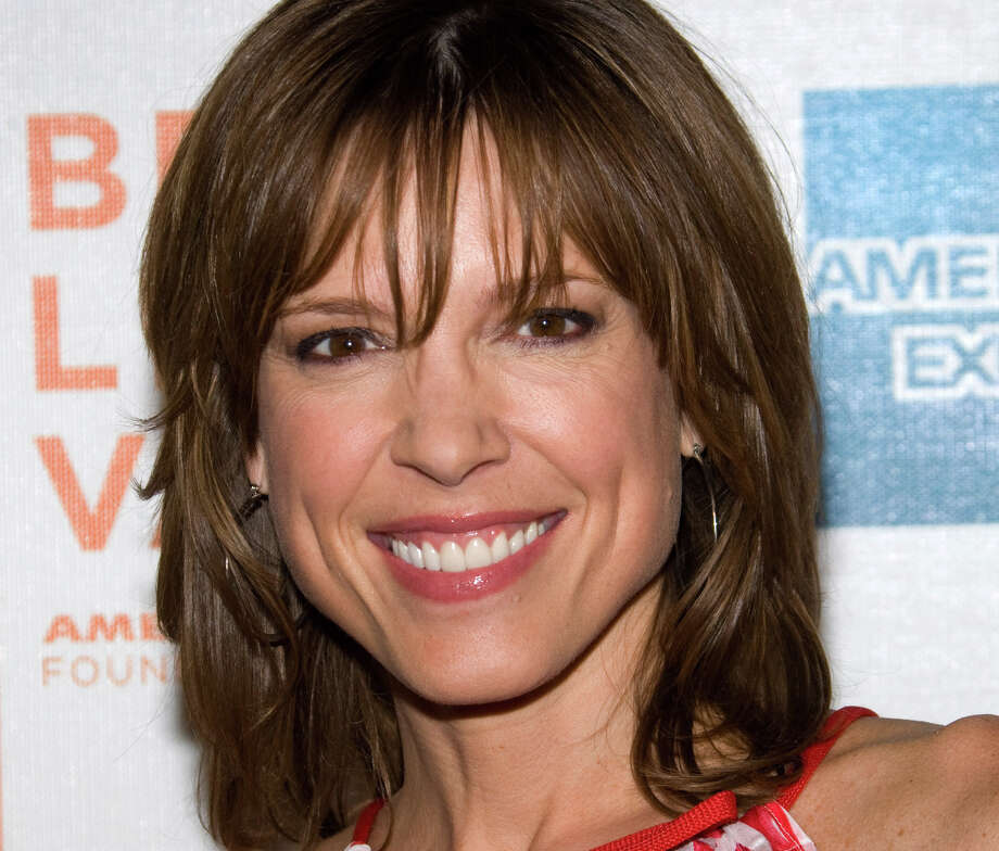"""FILE - In this Friday, April 23, 2010 file photo, Hannah Storm attends the premiere of """"Straight Outta L.A."""" as part of the Tribeca Film Festival in New York. ESPN anchor Storm will return to the air on New Year's Day, exactly three weeks after she was seriously burned in a propane gas grill accident at her home. Storm suffered second-degree burns on her chest and hands, and first-degree burns to her face and neck. She lost her eyebrows and eyelashes, and roughly half her hair. (AP Photo/Charles Sykes, File) Photo: Charles Sykes"""