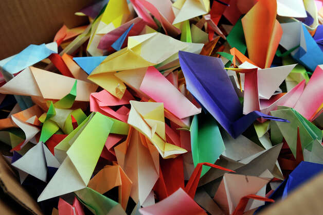 At Ridgefield Library people are making origami cranes that will be given to children in Newtown, Monday, Dec. 31, 2012. Photo: Carol Kaliff / The News-Times