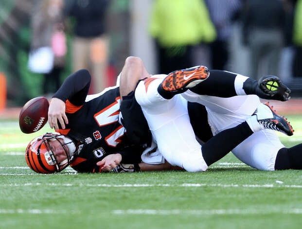 Quarterback Andy Dalton has a penchant for turnovers: Dalton has played well as one of six first-or-second-year quarterbacks who have their teams in the playoffs. But Dalton, a Katy native, became the first Bengals quarterback to throw an interception in eight straight games to start the season. He has 16 interceptions this season. Dalton has also been sacked 44 times. Photo: Andy Lyons / 2012 Getty Images