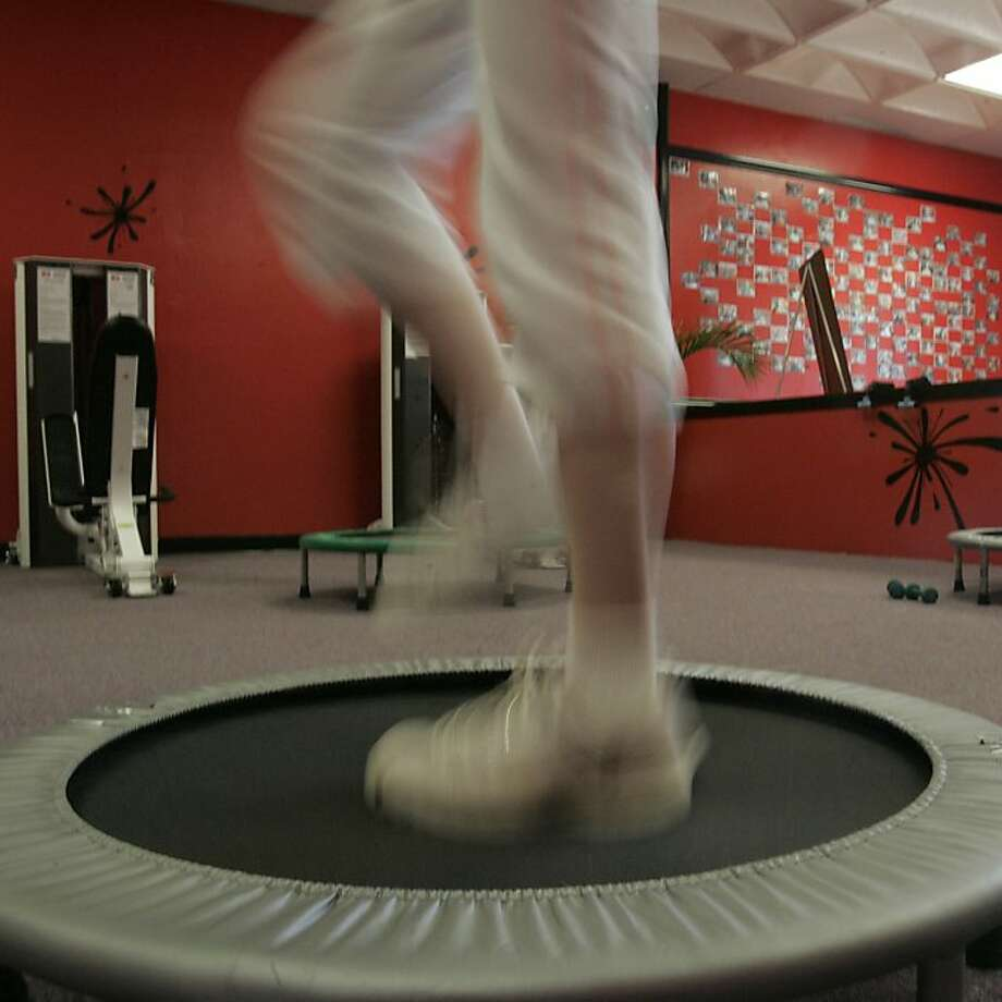 Working out on a trampoline is one form of physical activity that can help a person lose weight and become more fit. Walking is another. The key is regular and sustained behavioral changes. Photo: Penni Gladstone, San Francisco Chronicle