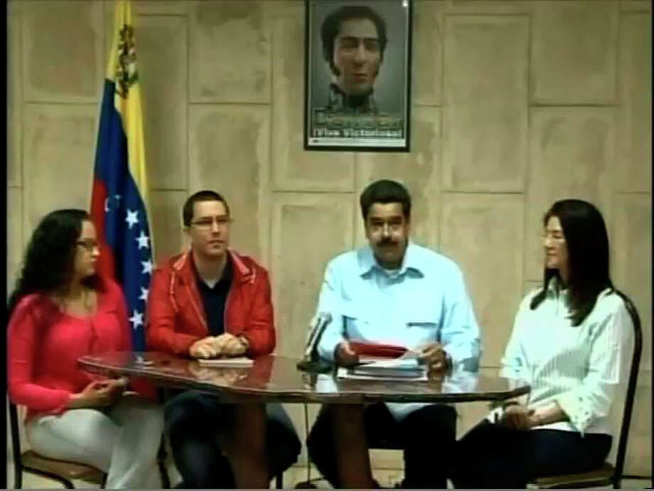 "In this frame grab taken from the government owned Venezolana de Television, Venezuela's Vice-President Nicolas Maduro, second right, speaks next to Minister of Technology Jorge Arreaza, second left, Venezuela's president Hugo Chavez's daughter Rosa Virginia, left, and Attorney General Cilia Flores, right, in a televised address from Havana, Cuba, Sunday, Dec. 30, 2012. Maduro said President Hugo Chavez has suffered ""new complications"" following his cancer surgery. (AP Photo/VTV) Photo: HOEP / VTV"