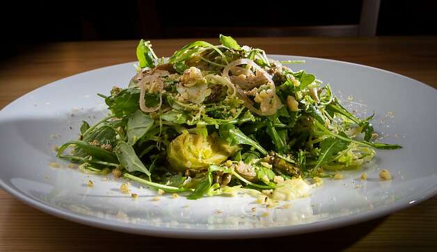 The Brussels sprout salad has a cider and shallot vinaigrette, seared and shaved sprouts, walnuts and oyster mushrooms. Photo: John Storey, Special To The Chronicle