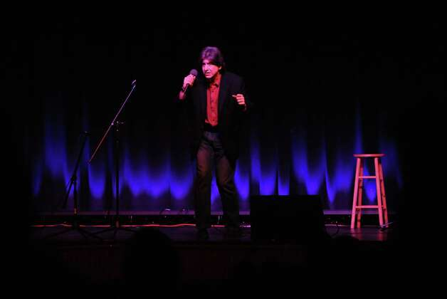 Comedian Buddy Flip entertains the crowd at Palace Danbury Saturday evening Dec. 31, 2012, in Danbury Conn. Flip was this year's Vaudeville headliner for First Night Danbury. Photo: Will Waldron, Will Waldron/Hearst Newspapers