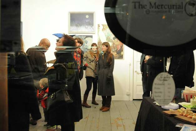 Patrons gathered at Mercurial Gallery on Library Place Saturday evening, Dec. 31, 2012, during First Night Danbury. The gallery featured an art exhibition, musical performance and other attractions. Photo: Will Waldron, Will Waldron/Hearst Newspapers