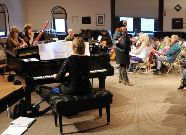 The musical group Madera Vox engaged audience members at Danbury Music Centre Saturday evening Dec. 31, 2012, during First Night Danbury celebrations. Madera Vox started with an abbreviated version of their self styled theatrical concert called âÄúBlack BearâÄôs Hudson Valley Tale.âÄù Photo: Will Waldron, Will Waldron/Hearst Newspapers