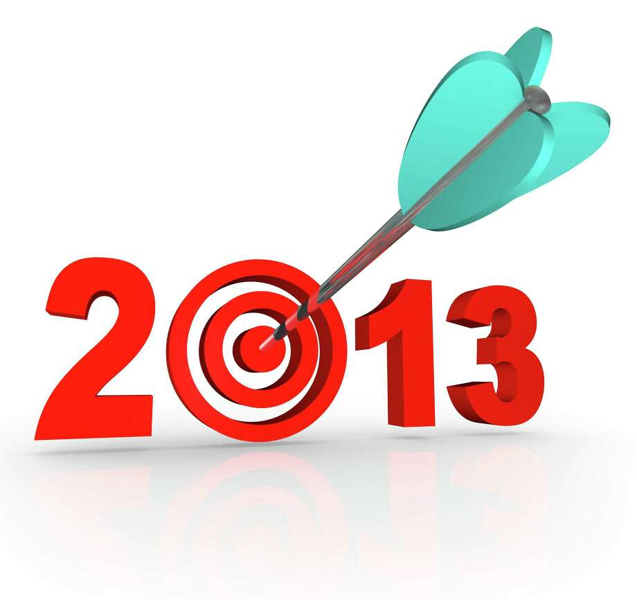 The year 2013 with an arrow in a bullseye target inside the number to symbolize targeted goals for the new year Photo: IQoncept / iQoncept - Fotolia
