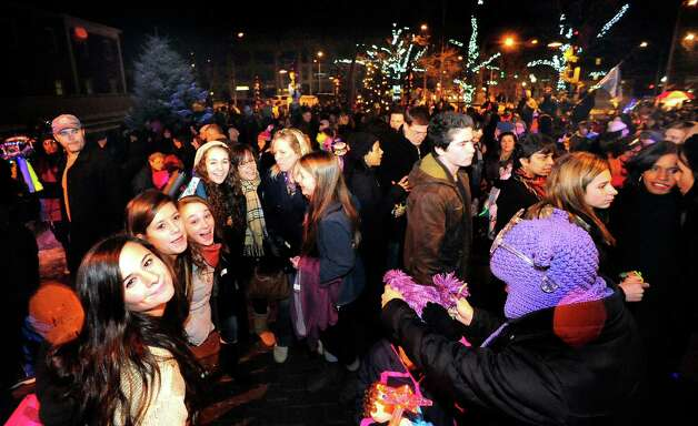 Revelers party outside the Danbury Library as part of a First Night celebration Monday, Dec. 31, 2012. Photo: Michael Duffy / The News-Times