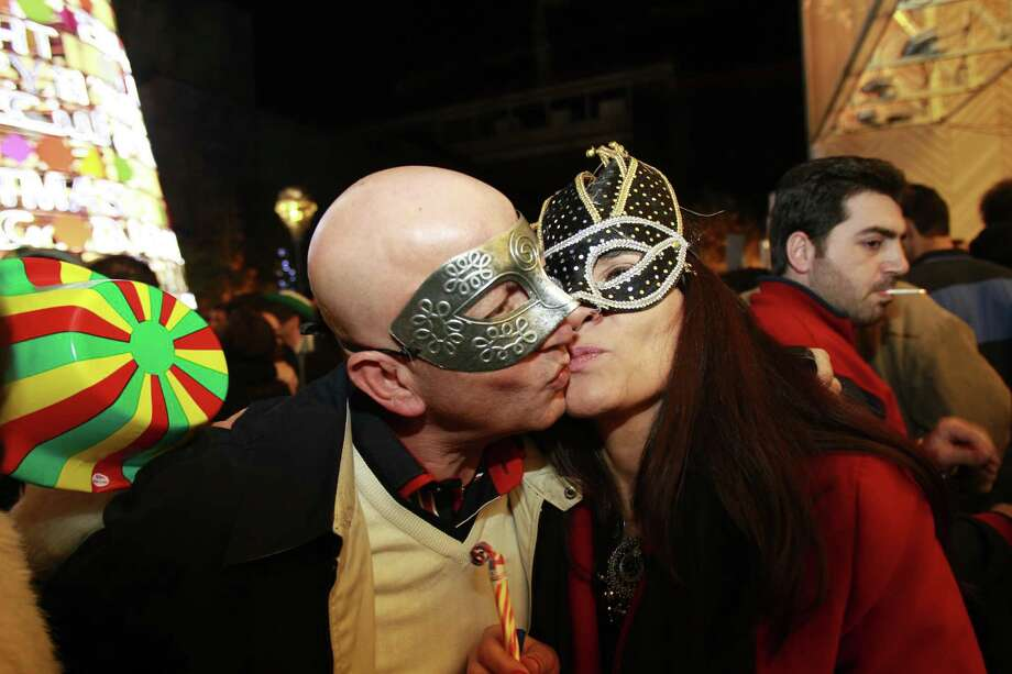 Lebanese people kiss as they celebrate on new year's eve in Beirut, early on January 1, 2013. AFP PHOTO / ANWAR AMROANWAR AMRO/AFP/Getty Images Photo: ANWAR AMRO, AFP/Getty Images / AFP