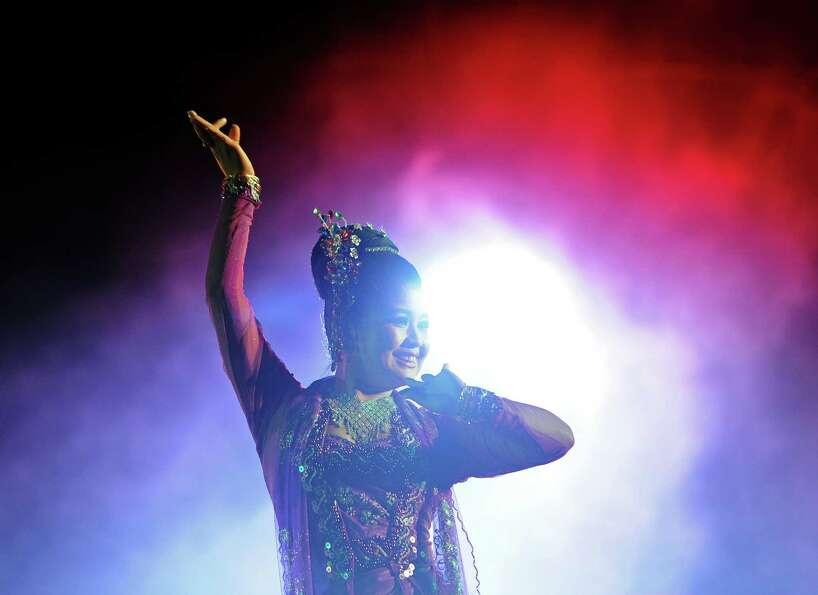 A woman performs during an event marking the first public countdown to the New Year in Yangon on Dec