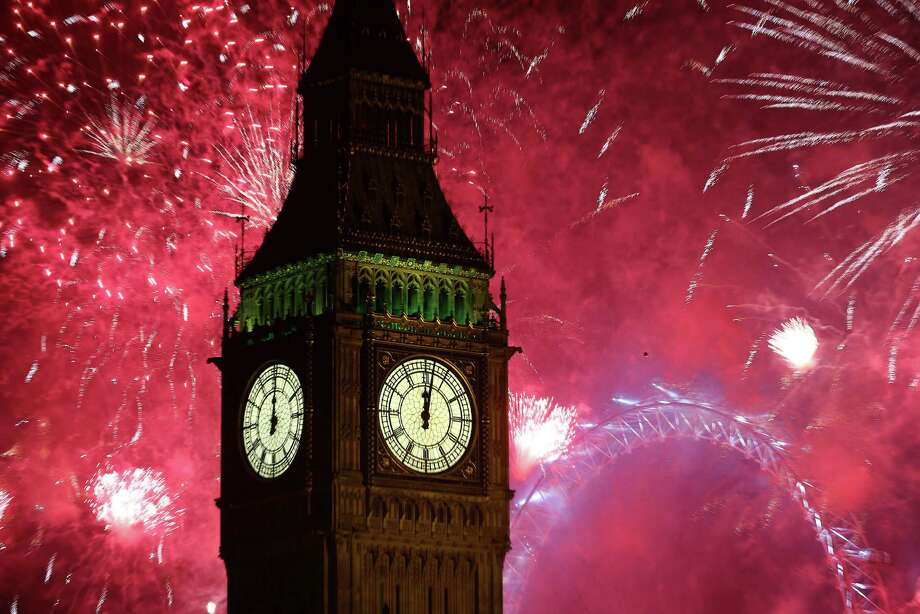 LONDON, ENGLAND - JANUARY 01:  Fireworks light up the London skyline and Big Ben just after midnight on January 1, 2013 in London, England. Thousands of people are lining the banks of the River Thames near Parliament in central London to herald the start of 2013. Photo: Peter Macdiarmid, Getty Images / 2013 Getty Images