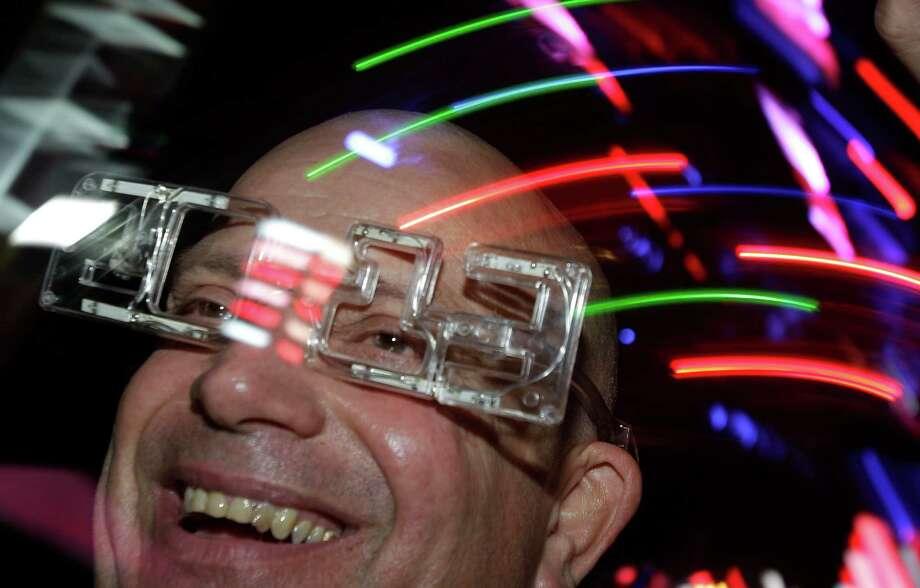 Michael Raitano of Houston celebrates during the New Year's Eve Houston event at Discovery Green Monday, Dec. 31, 2012, in Houston. Photo: Melissa Phillip, Houston Chronicle / © 2012 Houston Chronicle
