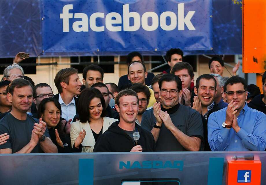 In this May 18, 2012 file photo provided by Facebook, Facebook founder, Chairman and CEO Mark Zuckerberg, center, rings the Nasdaq opening bell from Facebook headquarters in Menlo Park, Calif. Years of anticipation led to Facebook's initial public offering of stock in 2012, the hottest Internet IPO since Google's in 2004. Many of the 1 billion-plus users of the world's largest online social network craved a chance to buy in early. On the eve of its first trading day, Facebook's market value was $105 billion, yet the IPO bombed. (AP Photo/Nasdaq via Facebook, Zef Nikolla, File) Photo: Zef Nikolla, Associated Press