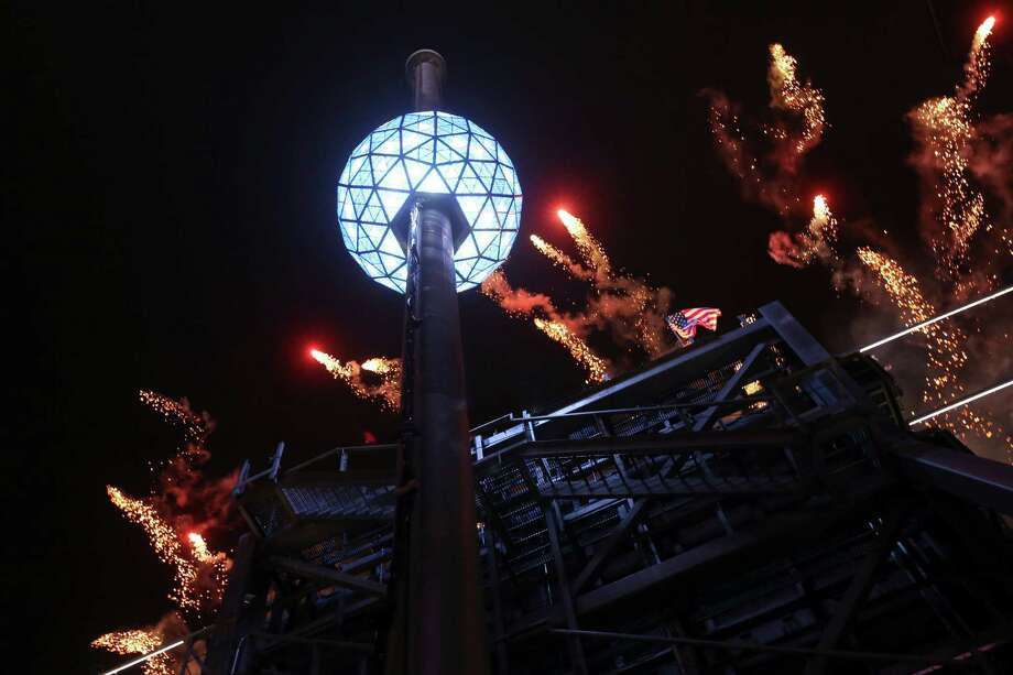 Accompanied by fireworks galore, the Waterford crystal ball is raised to its pinnacle at the beginning of New Year's celebration in New York's Times Square on Monday. Photo: Mary Altaffer, STF / AP