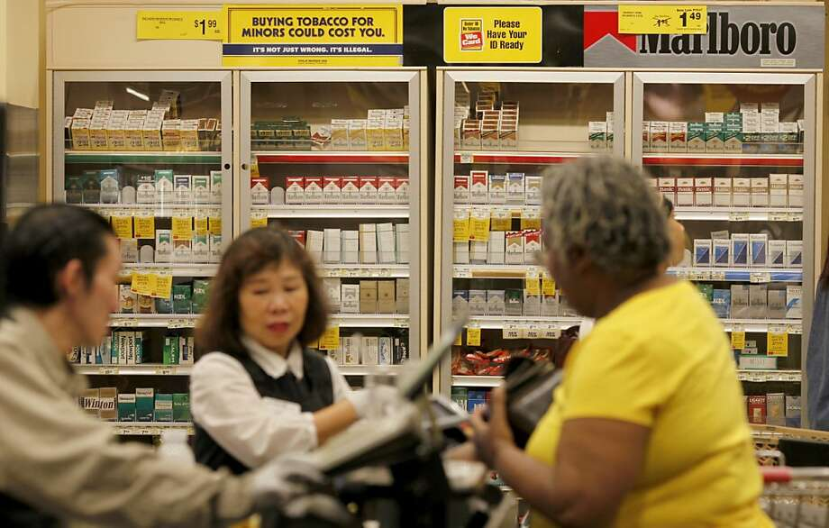 The cigarette storage area at the Safeway at Webster and Geary Streets is locked like all Safeway stores in the city. The San Francisco, Calif. Board of Supervisors is voting Tuesday September 21, 2010 on a measure which would outlaw the sale of cigarettes in grocery or big box stores that have pharmacies like all Safeway stores. Photo: Brant Ward, The Chronicle