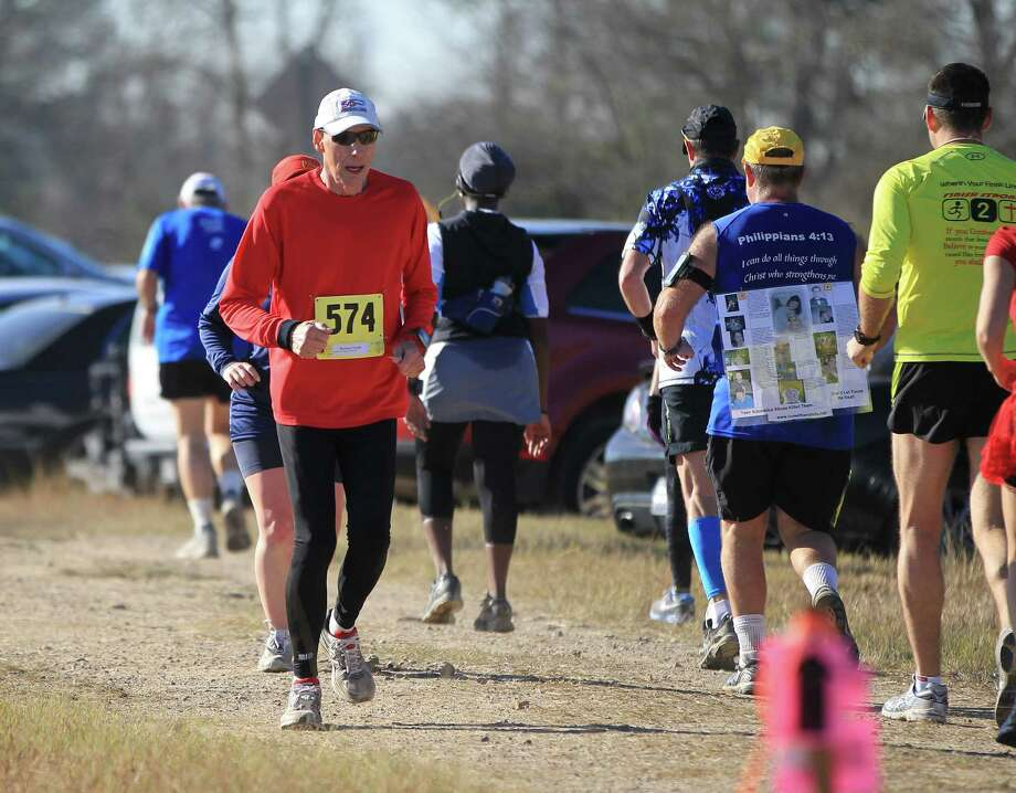 Jim Simpson, runs the marathon portion of The Day After the End of the World Marathon,Saturday, Dec. 22, 2012, in Humble.   Simpson, hopes he will be running his 1,000th marathon on Jan. 1, 2013, in Kingwood, which  would make him the first American to do so.  He travels in a camper and parks at Walmarts, running marathons every weekend. ( Karen Warren / Houston Chronicle ) Photo: Karen Warren, Staff / © 2012 Houston Chronicle