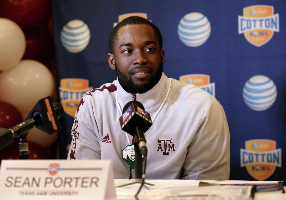 Texas A&M's Sean Porter listens to a reporters question during an NCAA Cotton Bowl football game press conference Monday, Dec. 31, 2012, in Irving, Texas. Texas A&M will play Oklahoma Friday night in the bowl game at Cowboys Stadium. (AP Photo/Tony Gutierrez) Photo: Tony Gutierrez, Associated Press / AP
