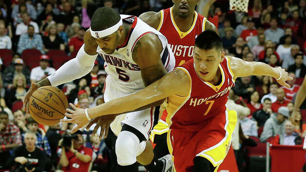 Rockets guard Jeremy Lin attempts to steal the ball from Hawks forward Josh Smith. Photo: Scott Halleran / 2012 Getty Images