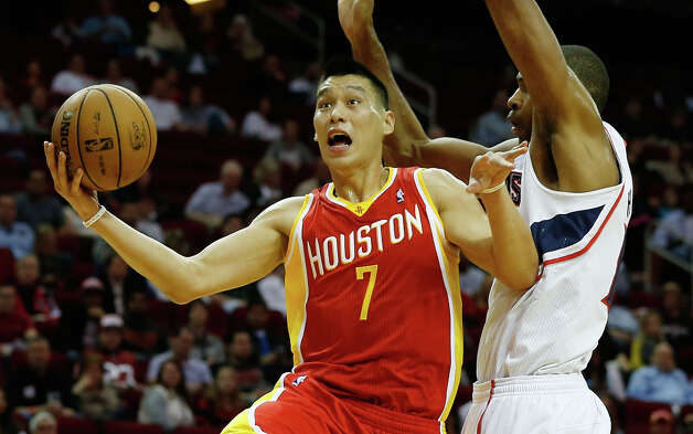 Rockets point guard Jeremy Lin shoots over Hawks forward Al Horford. Photo: Scott Halleran / 2012 Getty Images