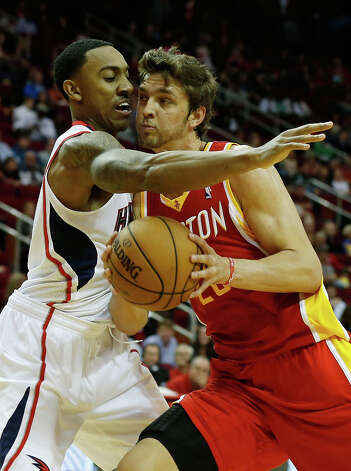 Rockets forward Chandler Parsons drives against Jeff Teague of the Hawks. Photo: Scott Halleran / 2012 Getty Images