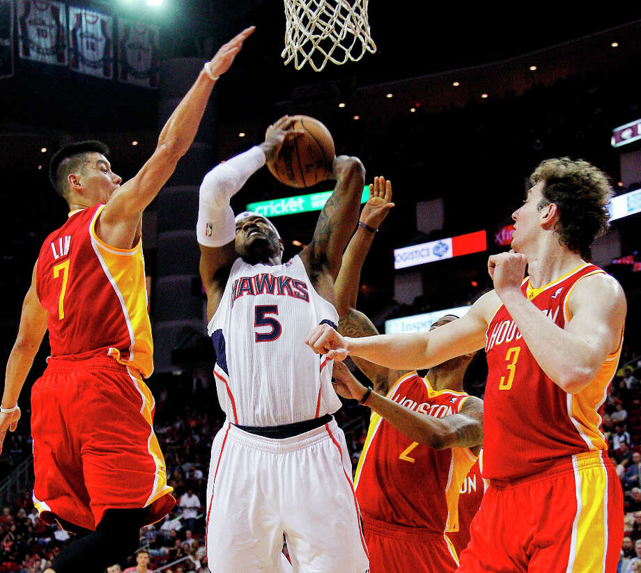 Hawks forward Josh Smith has a shot blocked by Rockets point guard Jeremy Lin. Photo: BOB LEVEY