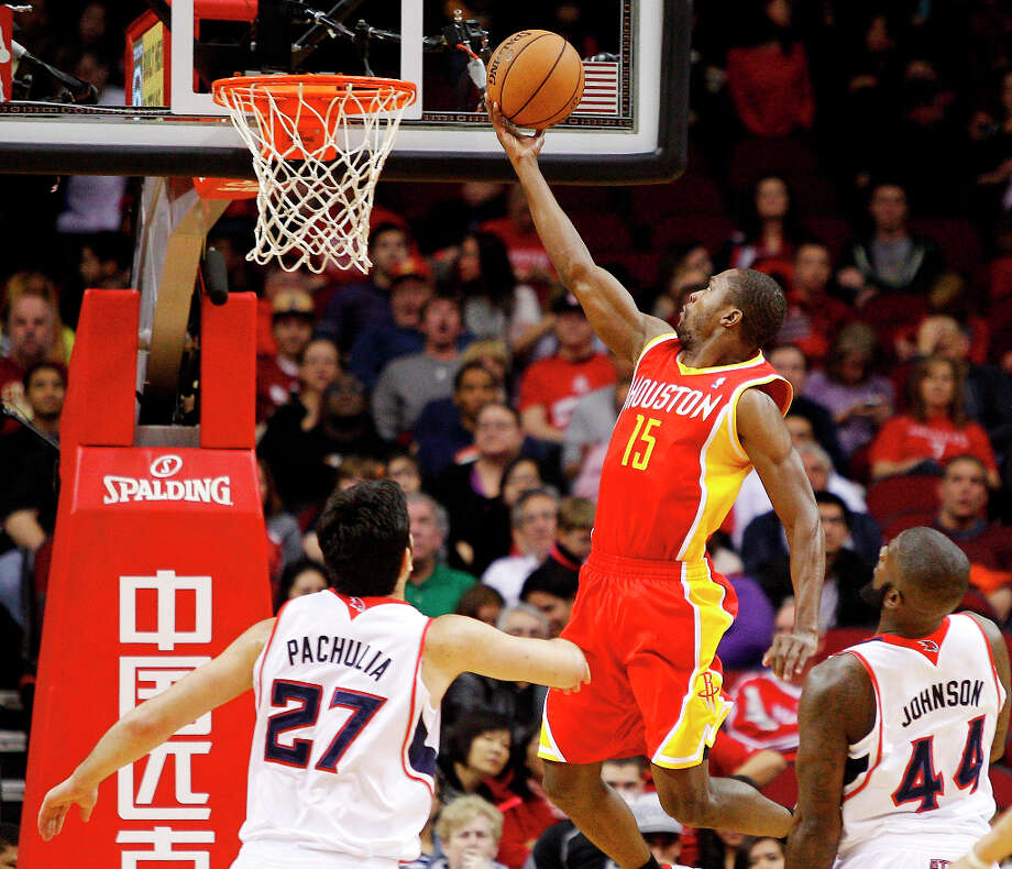 Rockets guard Toney Douglas gets a layup against the Hawks. Photo: BOB LEVEY