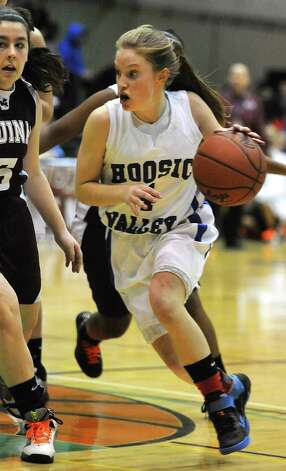 Hoosic Valley's Cassidy Chapko drives to the basket during a basketball game against Aquinas in the class B girl's state semifinals at Hudson Valley Community College in Troy, NY on March 18, 2011. (Lori Van Buren / Times Union) Photo: Lori Van Buren / 00012412A